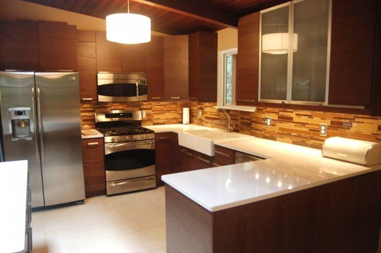 Narrow kitchen with IKEA kitchen cabinets built all around the doorframe