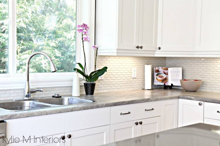 White ceramic tile backsplash in the kitchen adds depth to the setting  [From: Andrew