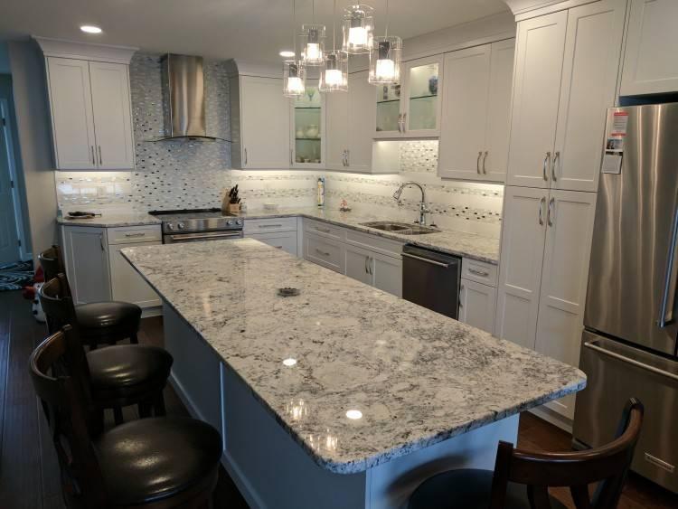Kitchens + Canyon Granite Travertine & Glass Back  splash White Ice