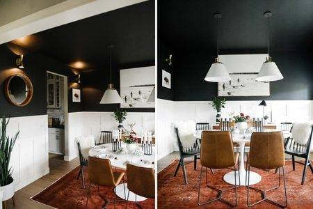 Black and white kitchen with small round table and two chairs in the corner