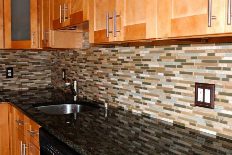Kitchen backsplash featuring industrial tile laid horizontally