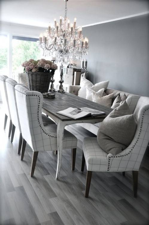 Grey rustic dining table with beautiful fabric chairs