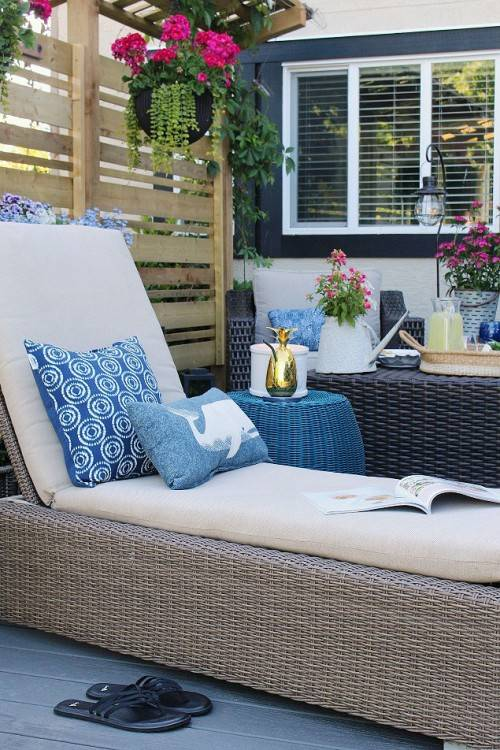 Beautiful summer patio decorated with pops  of blue