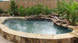 An attached spa is constructed outside or adjacent to the pool