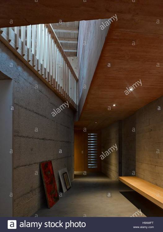 View of dining area with wooden table  set and red wall hallway