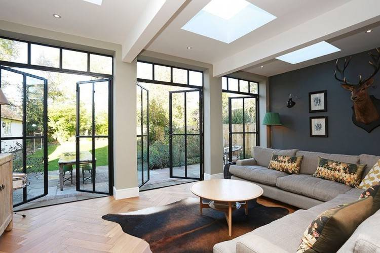 View in gallery Sectional glass garage door used in an eclectic living room