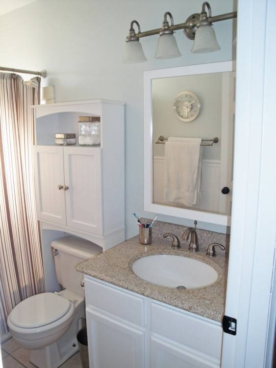 Fabulous bathroom with light gray paint on top half of walls and white  beadboard on bottom half of walls framing window in lieu of mirror with  gray cornice