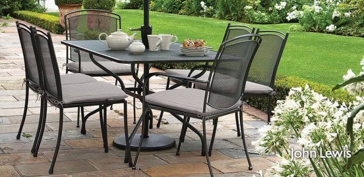 Outdoor picnic table with attached benches