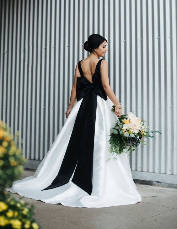 Consider adding some black elements to your white wedding gown without  going all black and shocking your elders