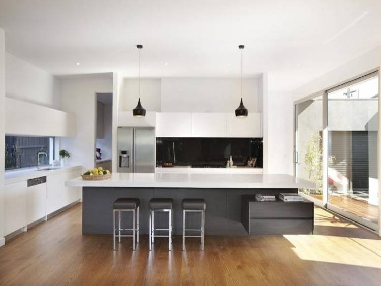 The Latest Trends in Kitchen Island Design Trade Lines for Curves and Mixed  Materials for Monolithic