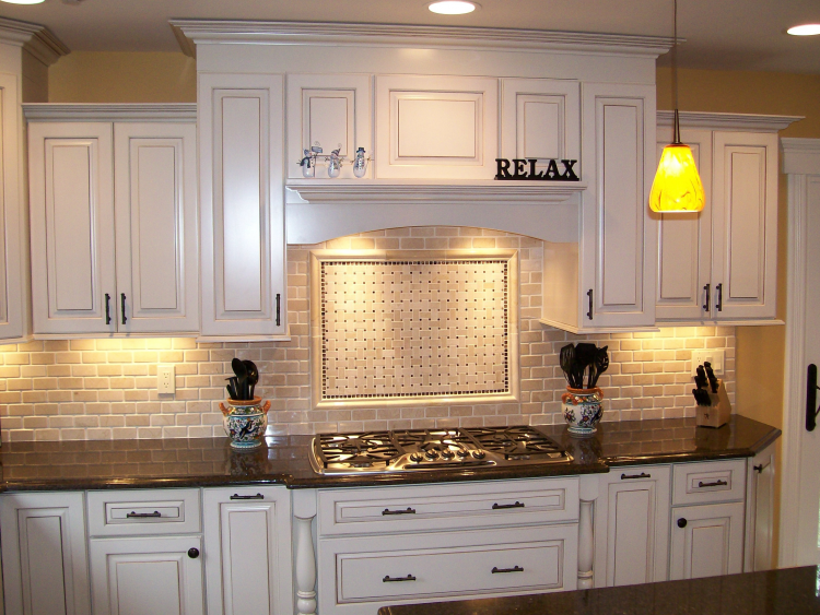 Off white with clipped corners on the bump out sink, granite  countertop, arched valance