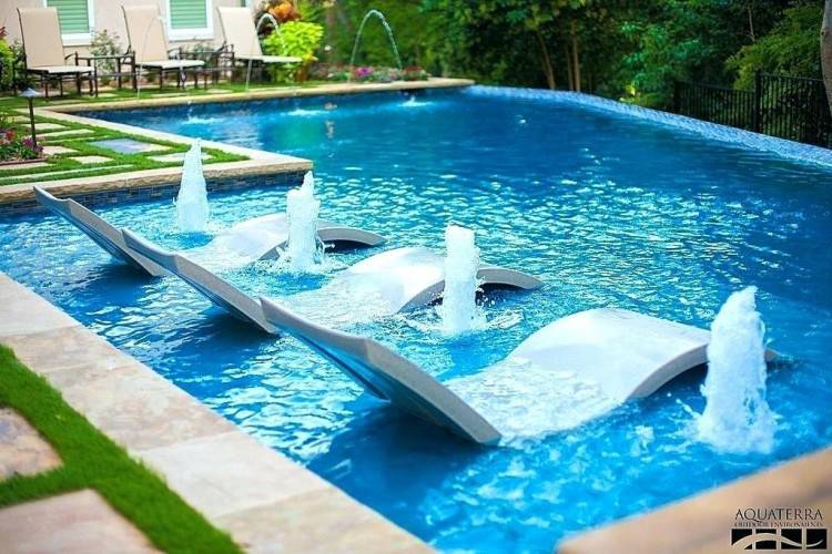 free form outdoor swimming pool design with blue lounge chairs plans  software