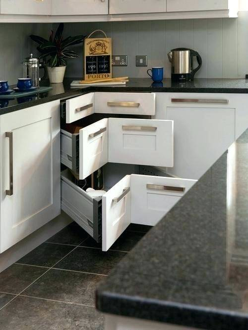 Curvy corner drawers steal the show in this kitchen [Design: Grace Blu  Designs]