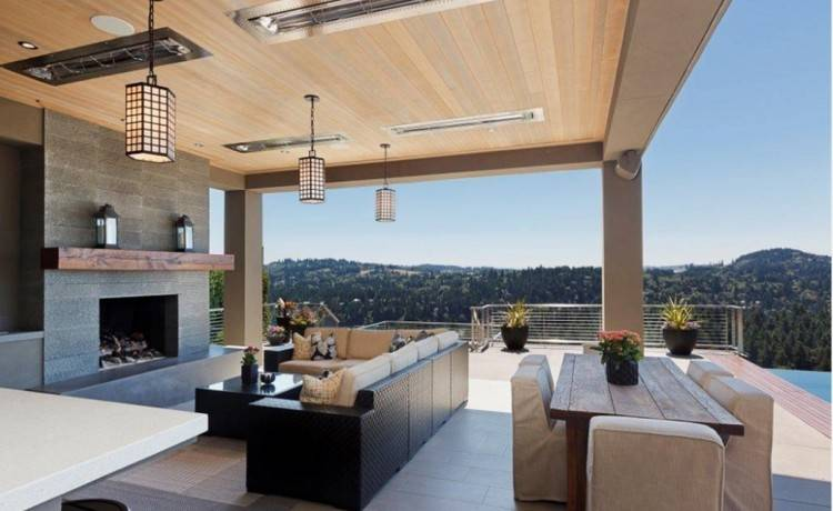 in a living room as outside under a barbecue area? The fireplace  flanked by open views on either side will provide warmth to guests  snuggling around it,