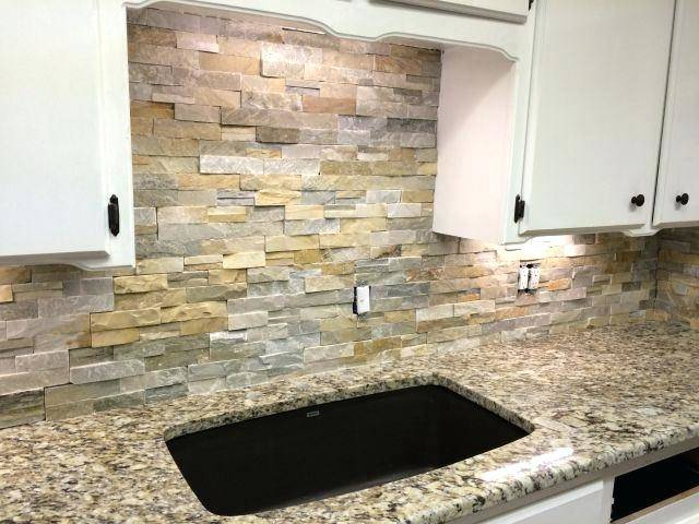 Marmi Natural Stone makes a statement with this kitchen design featuring a  marble island and countertop that transitions to a full wall backsplash