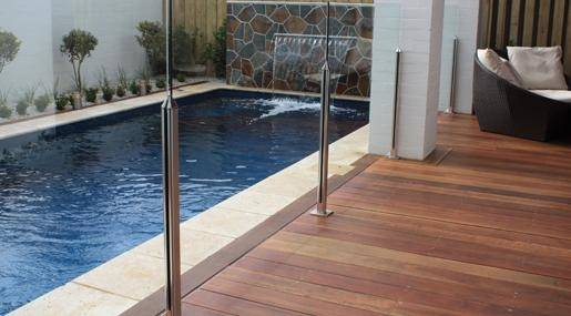 An above ground post and rail swimming pool fence design