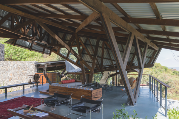 A complex, angled structure shades and protects the main outdoor living  space