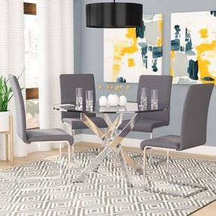 Small black dining table that extends to seat 6