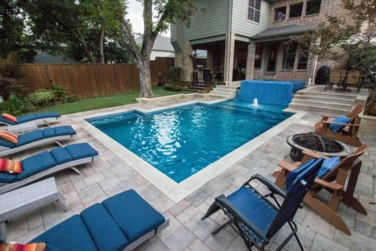 formal pool design with deck jets and pergolas