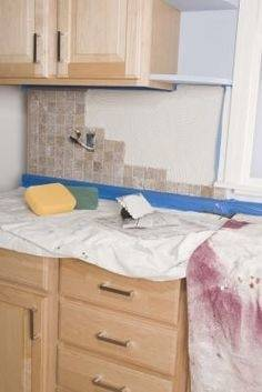Backsplash tile tips: If the tile will go around any windows, remove the  apron molding from below the stool