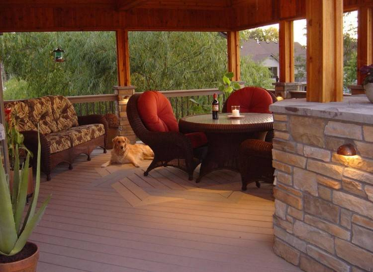 Open Porch over Belgard paver patio and outdoor kitchen, as viewed from the  deck