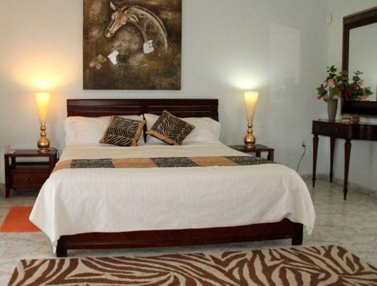 African inspired Senegal, this classic solid wood bed has 4 tall turned  corner posts, perfect to add drama to a room