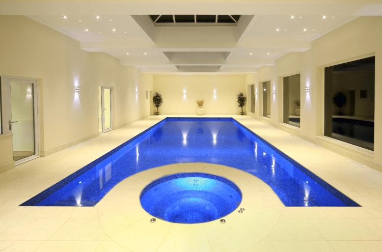 Luxurious Natural Rock Pool designed by Aqua Magic Pool and Spa of  California