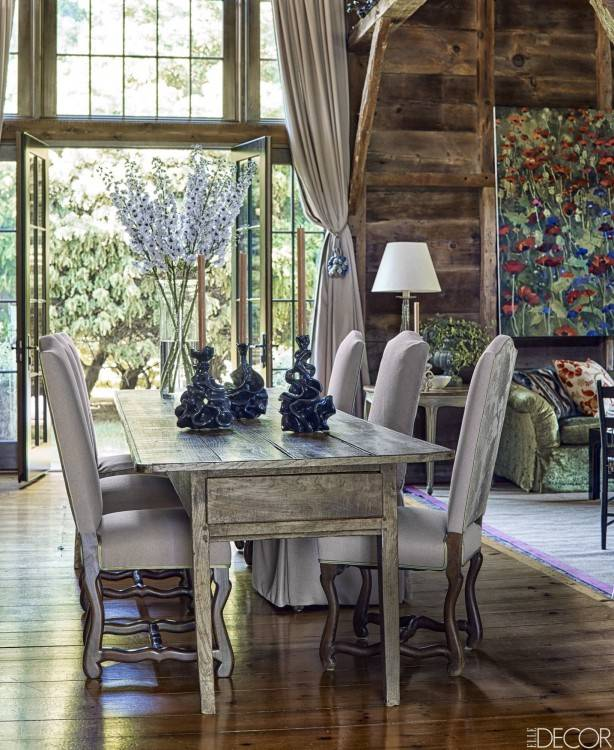 rustic  dining room table with modern chairs swinging