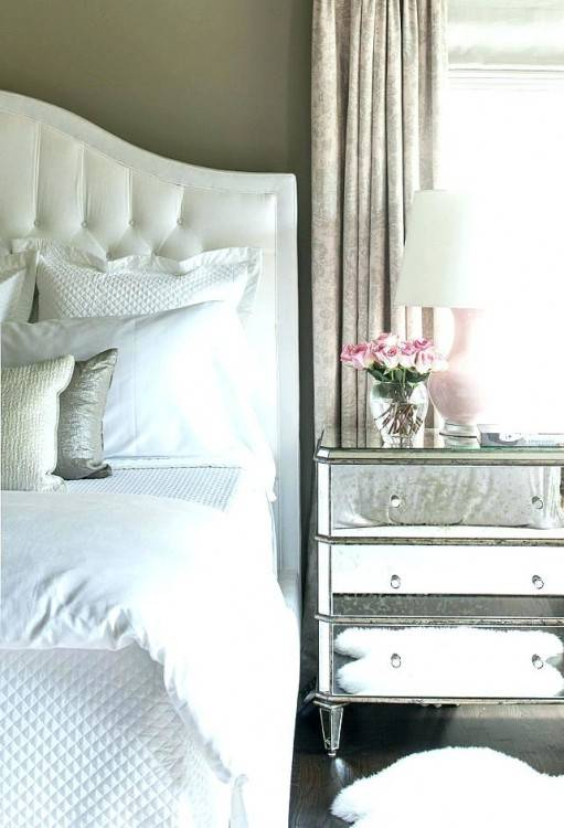 This silver nightstand was a DIY that works perfectly in this modern master  bedroom