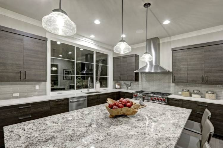 The owner is thrilled with her new, contemporary kitchen and the friend she  made in our designer