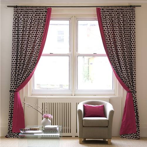 Flat shaped pelmets over draperies in this bay window treatment form a cozy  sitting area within the Master Bedroom