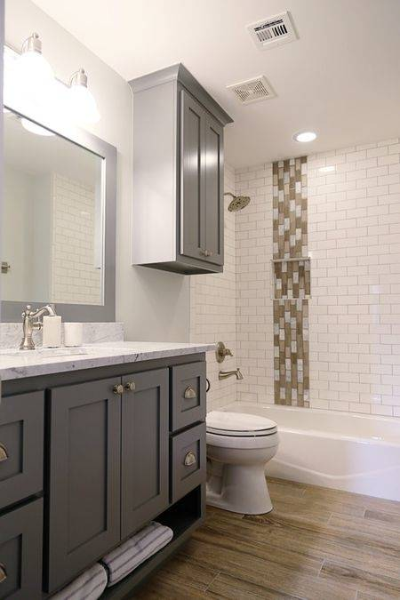 A white backsplash can reflect light to create a clean, bright vibe in your  bathroom
