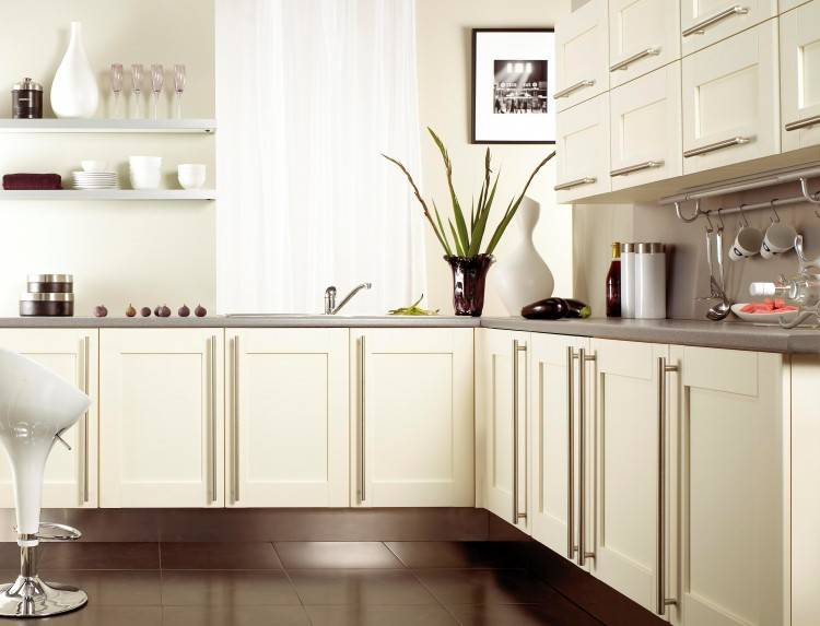See and interact with this kitchen · A kitchen featuring dark brown wood  grain cabinets and a white tile floor