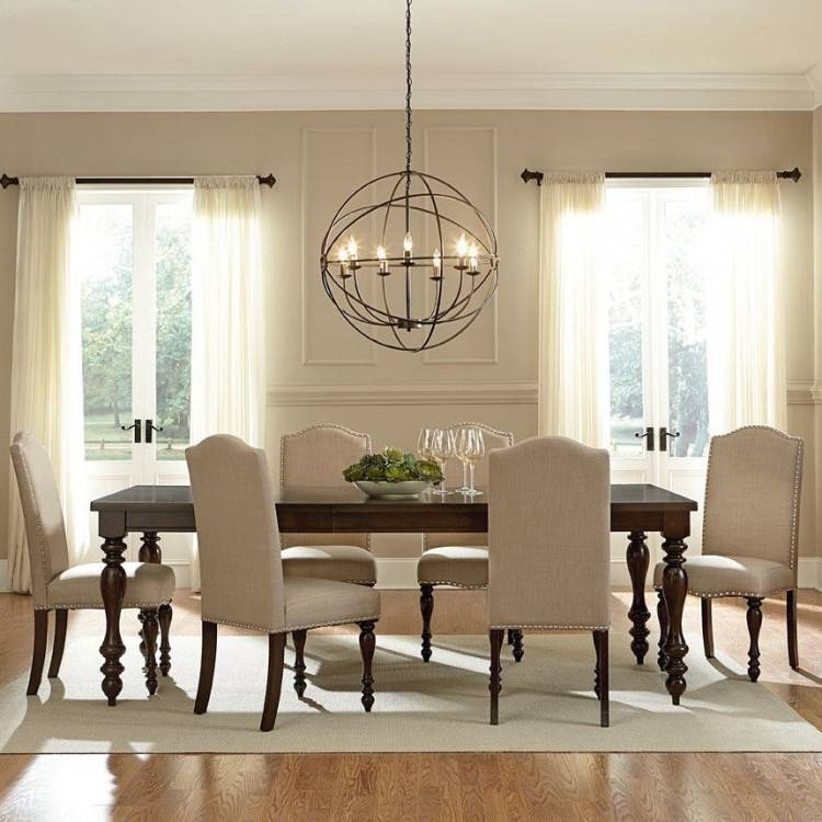 A handy rule of thumb is that a chandelier should be 12 inches narrower  than a table and have at least 48 inches of space from each of the room  walls or
