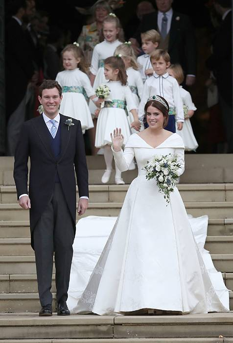 Spain's Princess Cristina and her new husband Inaki Urdangarin stroll along the gardens of Barcelona's Pedralbes Palace following their wedding at